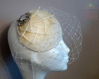 Vintage ivory cream bridal pillbox percher with sinamay leaves, birdcage veil and vintage crystal pendant