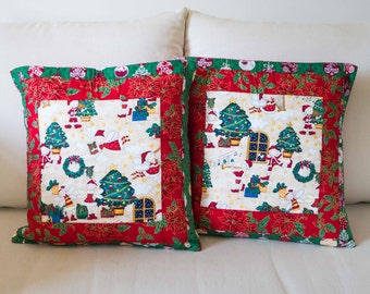 Set of Two Christmas Cushion Covers with Santas, Xmas Trees, Holly, Baubles and Poinsietta in Red and Green