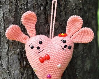 Peach crochet pendant rabbits heart. Double hares in love heart shape. FREE SHIPPING.