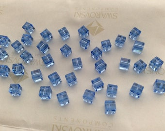 24 pieces Swarovski #5601 4mm Crystal Light Sapphire Cube Square Faceted Beads