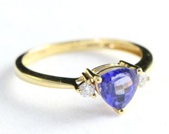 Tanzanite and diamond three stone engagement ring in 18 carat gold vintage