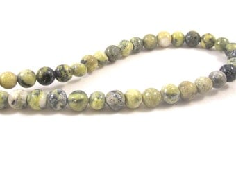 """RELO SALE - Bead, yellow """"turquoise"""" (natural), 6mm round, D grade, Mohs hardness 2-1/2 to 6. Sold per 15-inch strand."""