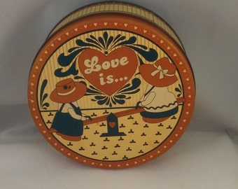 Love Is cannister tin, country tin, farm cookie tin, biscuit tin, yellow and russet country cookie tin, folk style metal tin cannister
