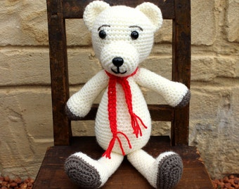 Handmade, crocheted toy teddy bear for children and babies in cream and red
