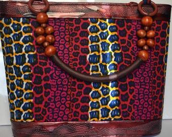 Beaded handle African Fabric and Leather handbag