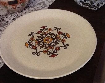 Retro dinner size plate with brown,red and yellows by johnson of Australia