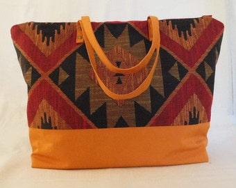 Handmade orange sunbrella and cotton upholstery fabric overnight or carry-on bag