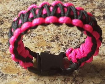 Paracord bracelet with emergency whistle