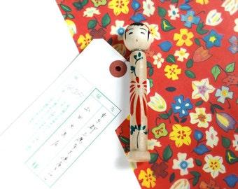Wooden Kokeshi doll Messenger