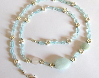 Romantic Aquamarine necklace with small silver flowers