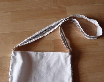 Brilliant white bag with side and shoulder strap