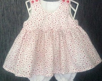 Little dress with red hearts and her panty