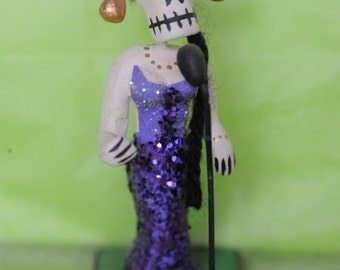Mexican Day of the Dead ceramic female singer in purple glitter dress