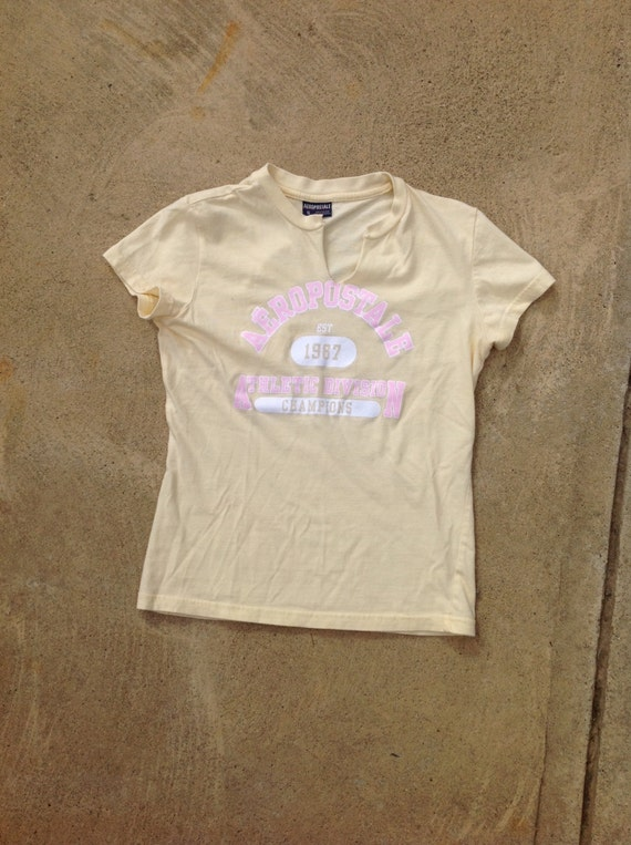 Vintage slit neckline SMALL pale yellow Aeropostale tee // SPARKLY logo, pink and white // Preppy school girl top // Cute, flirty
