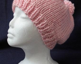 Pink hand-knit beanie
