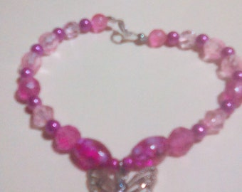 Pink bracelet with butterfly charm