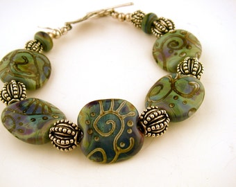 Comfortable Art Glass Bead Bracelet in blue green turquoise sterling leaf toggle clasp