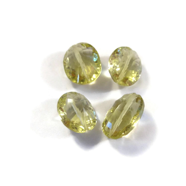 four lemon quartz yellow gemstones