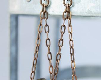 edgy long golden roller bead Czech glass natural brass earrings by CURRICULUM