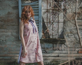 Bicolor collared pinafore dress in pink printed cotton and striped cotton, hot air balloon print.