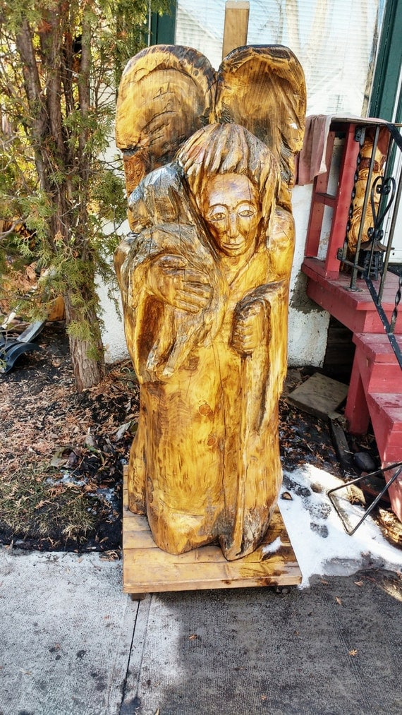 Items similar to wood angel holding lamb carving chainsaw