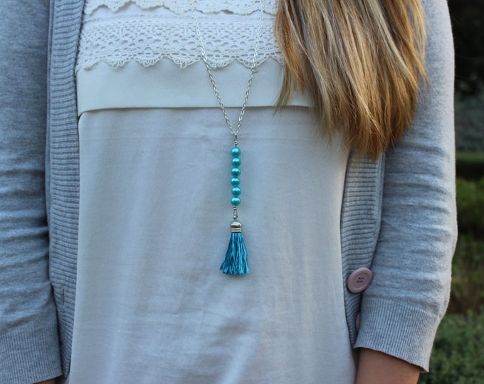 Blue tassel beaded necklace.