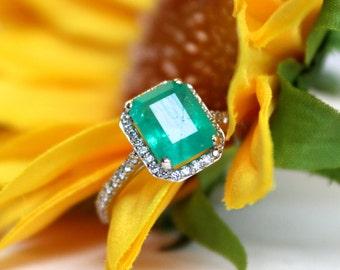 Emerald halo ring, diamond halo emerald engagement ring, white gold halo design,