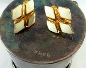 White diamond-shaped clip earrings