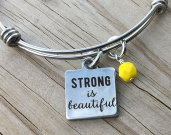 """Fitness Charm Bracelet- """"STRONG is beautiful"""" laser etched charm with an accent bead in your choice of colors"""