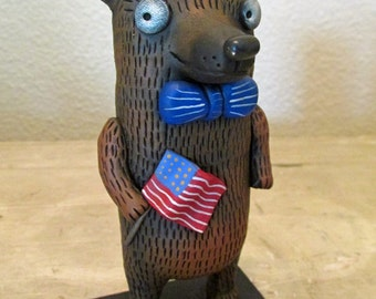 Fourth of July Patriotic bear with US flag and bow tie folk art by Janell Berryman Pumpkinseeds
