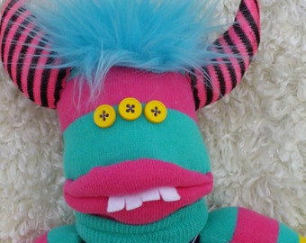 Sock monster named Ruthie is soft, cuddly and ready to be your friend.