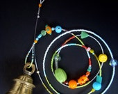 Indian temple bell on glassbeaded cord, clear ringing sound.... Strongbells around the world .........