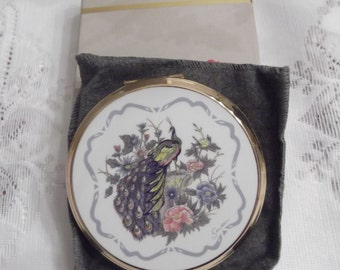 Stratton Powder Compact; Rondette; Featuring A Peacock/Floral Design On A White Enamel Background circa 1950's-1980's   DR121