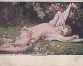 Love's Awakening- 1900s Antique Postcard- Cupid Art- Edwardian Romance- Angel Wings- Rose Garden- Postal Library Bureau- Paper Ephemera