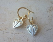 Sterling Silver Hearts on small 18k Gold Hoops . Amaré Earrings . Silver and Gold Jewelry . Hoop Earrings with Heart Charms. Valentine's Day