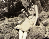 1920s photograph - original snapshot of a young lady on rocks with her parasol - Waipu Cove new Zealand - beach house decor