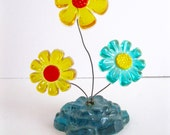 Vintage lucite flower arrangement Yellow blue daisy paperweight office decor