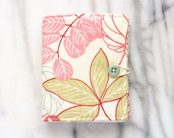 Needle book in pastel floral print and blue button closure with felt pages