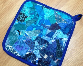 Handmade upcycled quilted hot pad