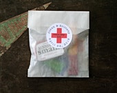 DIY Recovery Kit, first aid for wedding guests.  20 glassine favor bags with custom red cross stickers.  Hangover Kit for wedding guests.