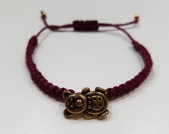 Wine Colored Macrame Bracelet with a Gold Bear