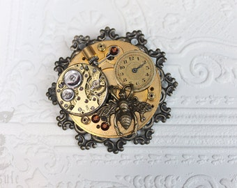 Gold Brass Steampunk Brooch with Bronze Filigree, Antique Pocket Watch Plate, Watch Movement and Dial, Bee and Swarovski Crystals