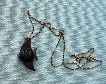 "matte black fish pendant on black & gold chain (32"")"