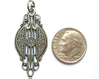 Beautiful Brittanium art deco charm that's perfect for earrings or as a pendant.