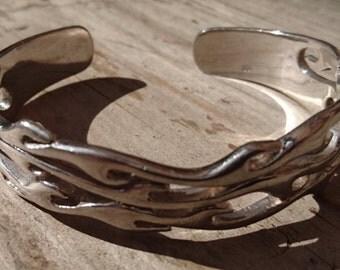 Vintage sterling silver flame design bangle