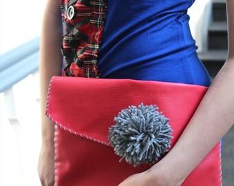 PVC Red Clutch Bag Grey Buttoned Pom Pom