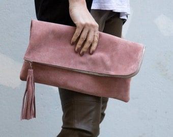 Suede leather clutch with tassel in pink