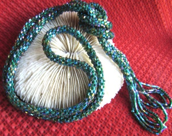 Beaded necklace hand made  green iris bugle beads, length 45 inches including the tassels at end.  Beautiful shade of green with iris effect