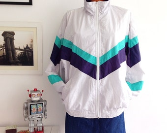 Vintage 80s Wthite with ribbons in green and blue Tracksuit, running jacket, Windbreaker. Size L