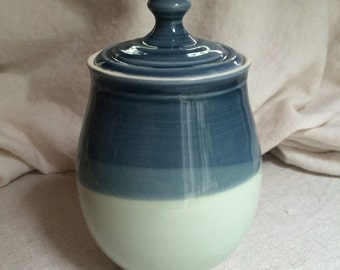 Handmade porcelain lidded jar in deep blue and light green